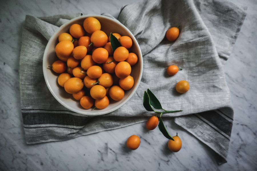 overhead view of a bowl filled with kumquats