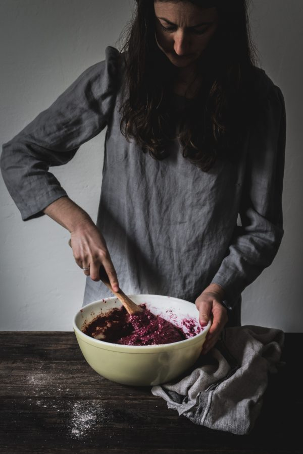 Woman mixing the batter for a chocolate beetroot cake