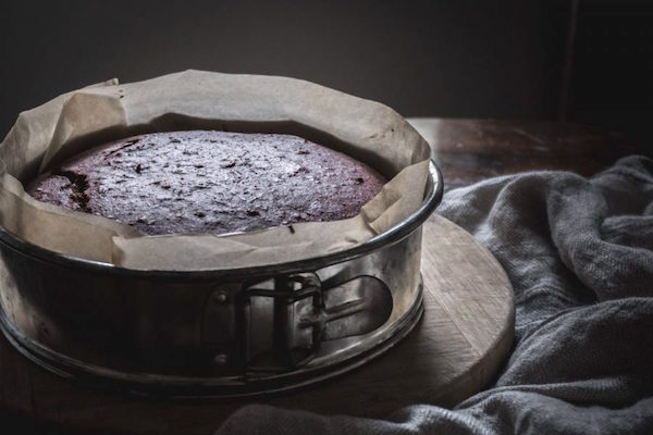 Fresh Baked Chocolate Beetroot Cake in a Spring Form Pan lined with Parchment Paper, just out of the oven.