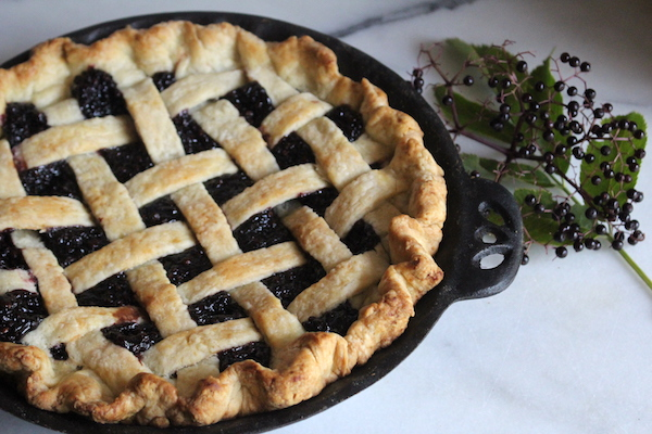 homemade elderberry pie baked with a lattice top pie crust
